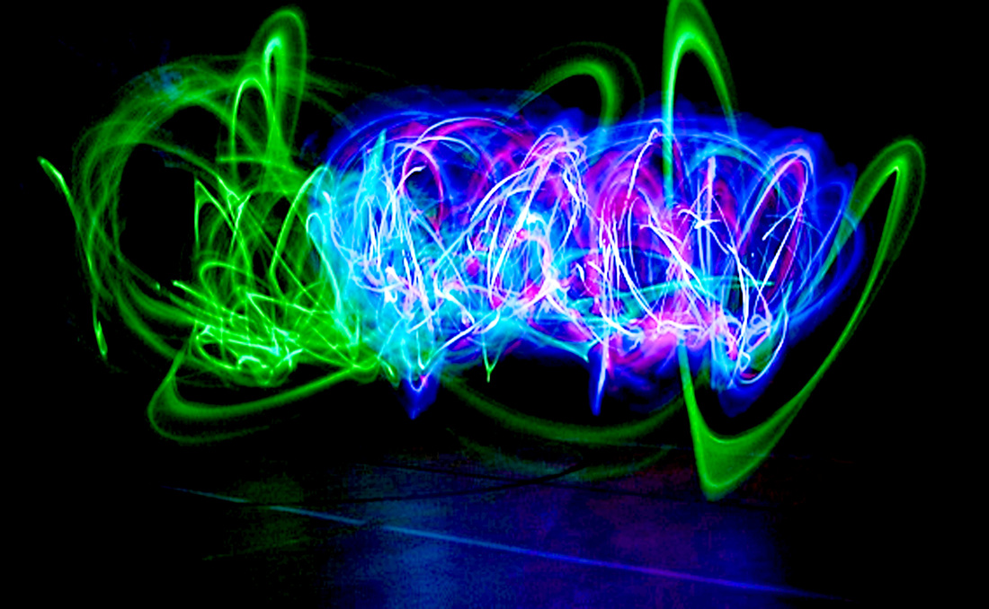 for the assignment light painting we set our camera at a long bulb setting we had different colored glow sticks and christmas lights wrapped around a